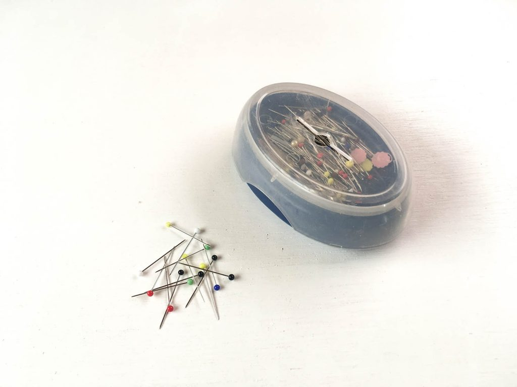 Glass headed sewing pins and magnetic pin cushion