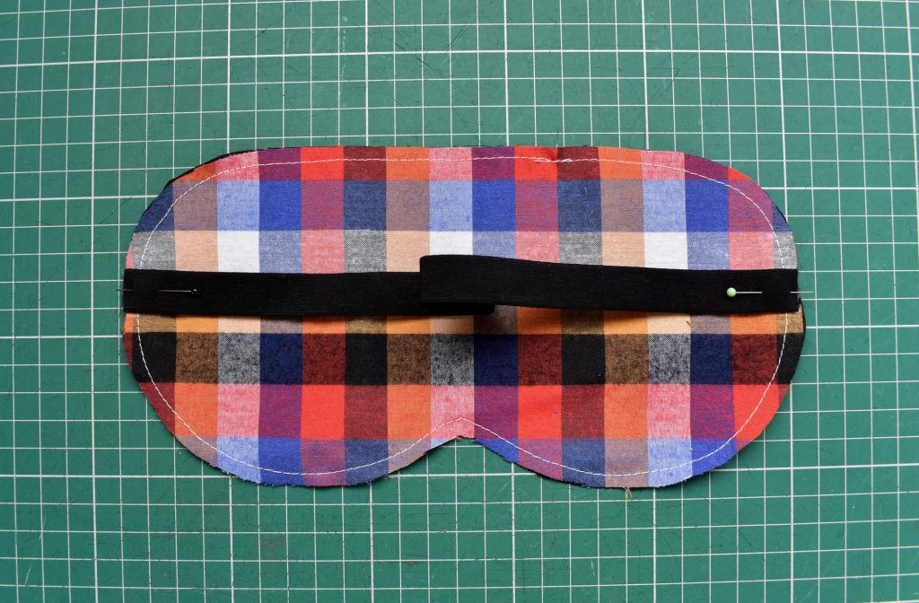 Pin strap elastic to sleep mask